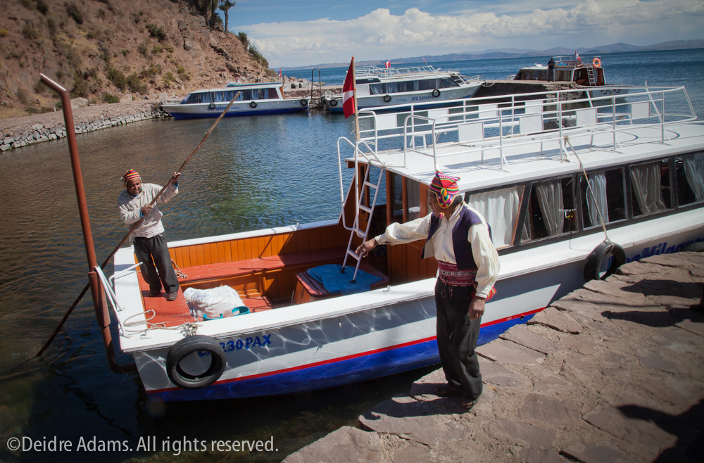 Boats at Taquile shore – ©Deidre Adams